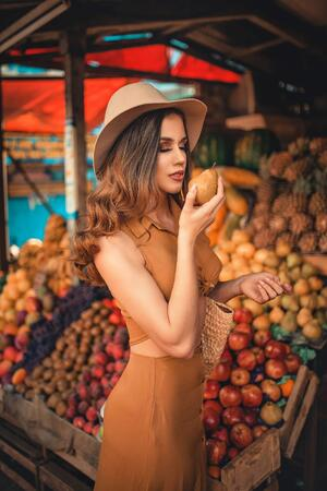 photo-of-woman-wearing-beige-dress-and-beige-fedora-hat-2846122